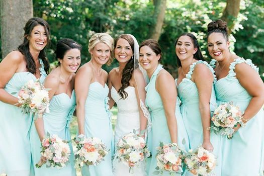 Beautiful bride and maids wearing mint green dresses