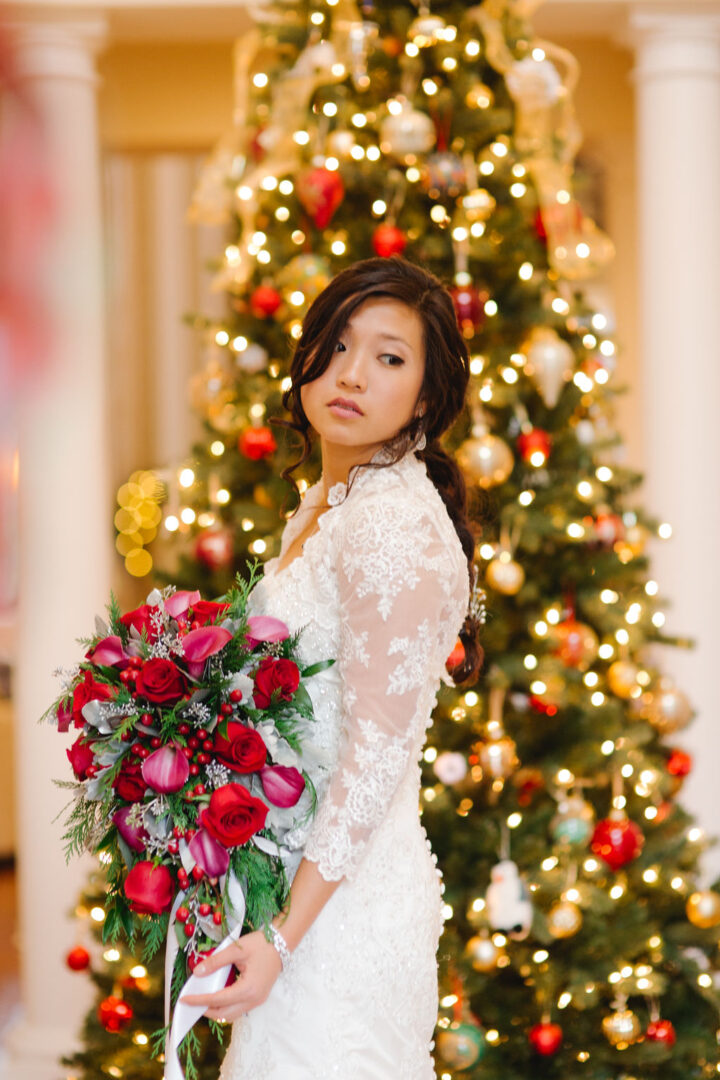 Christmas bride with beautiful makeup and hair by a Christmas tree