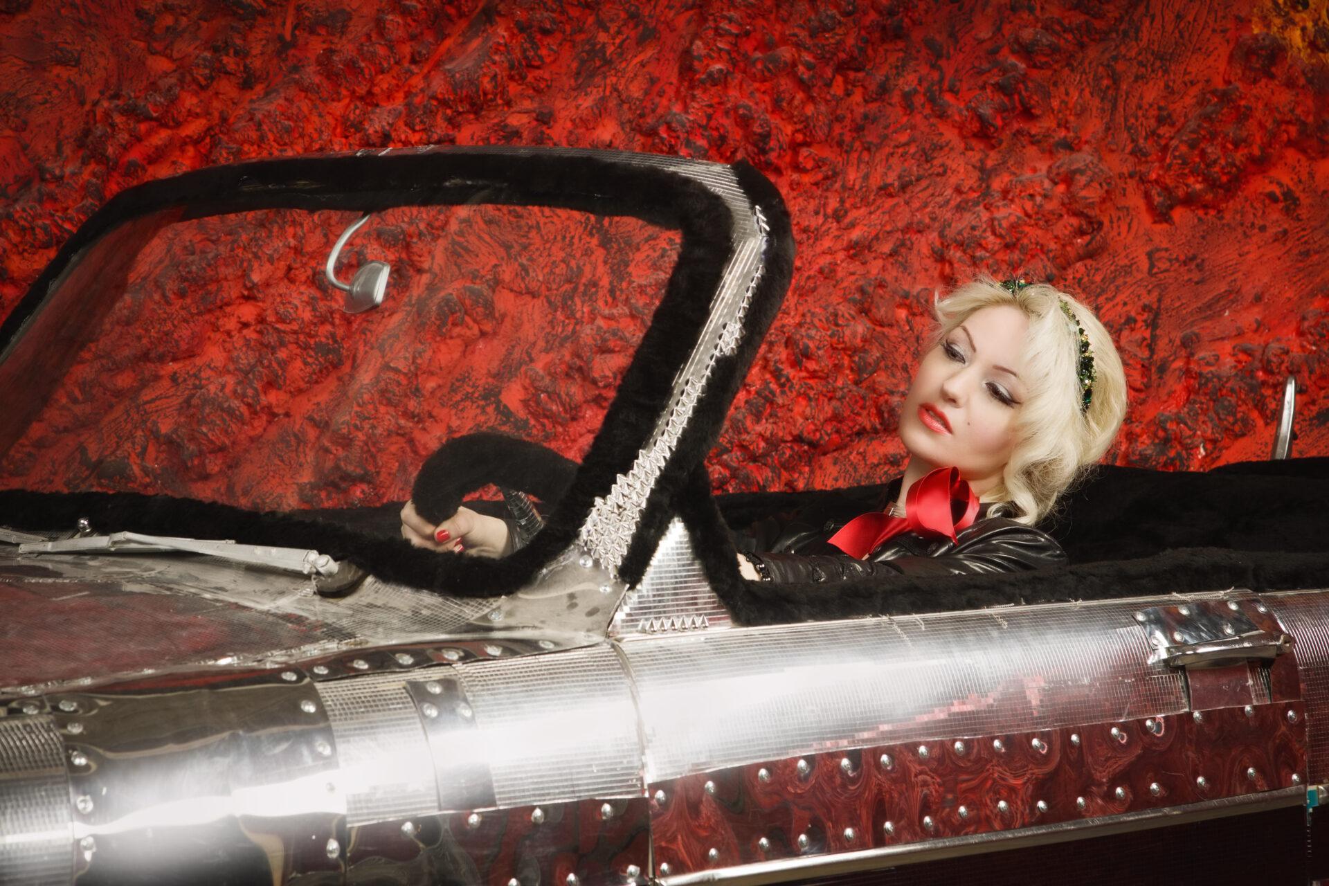 women driving a vintage Antique car