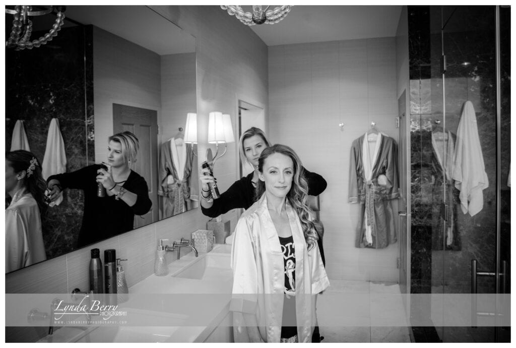 bride getting her wedding day hair styled