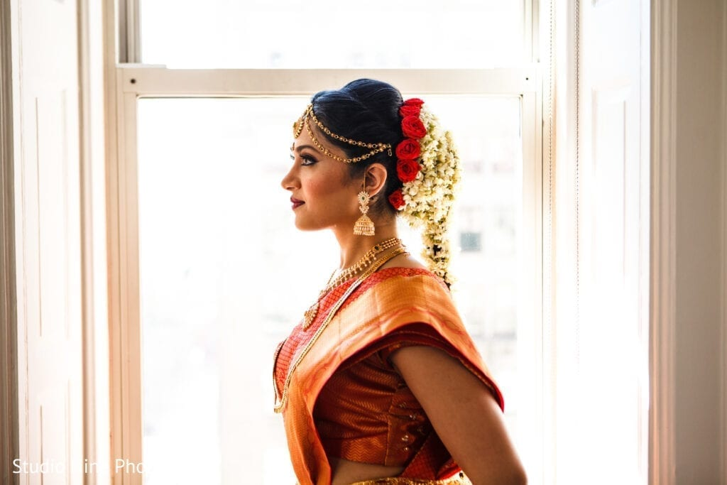 Beautiful South Asian bride showing off hair and makeup