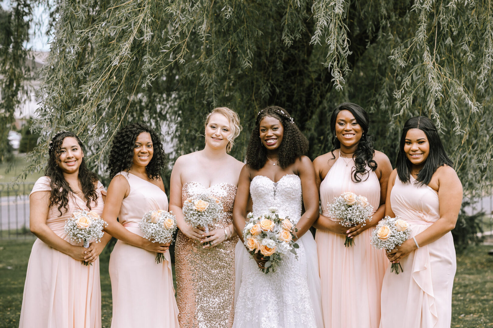 African American bride with bridesmaids