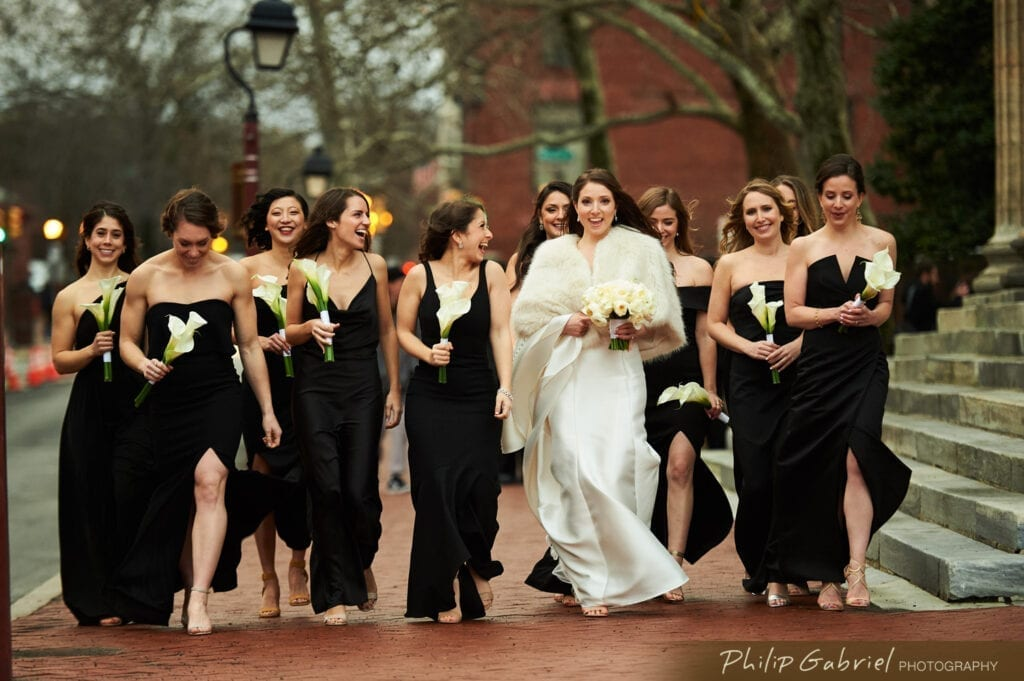 Bride and bridesmaids walking down the streets of Philadelphia