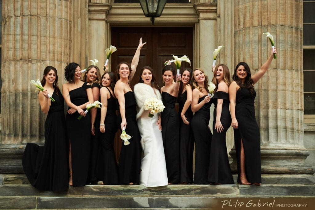 Bride and bridesmaids having fun