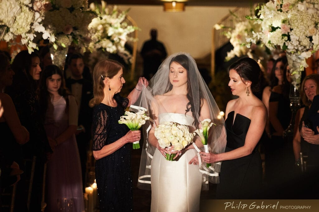Bella Angel bride with mom and sister at Ballroom at the Ben Philadelphia walking down the aisle