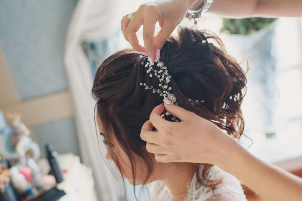bride having her tiara adjusted at her trial
